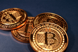 Fake Bitcoin spread out on a table