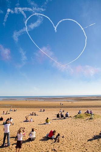 heart shaped vapor trail in sky