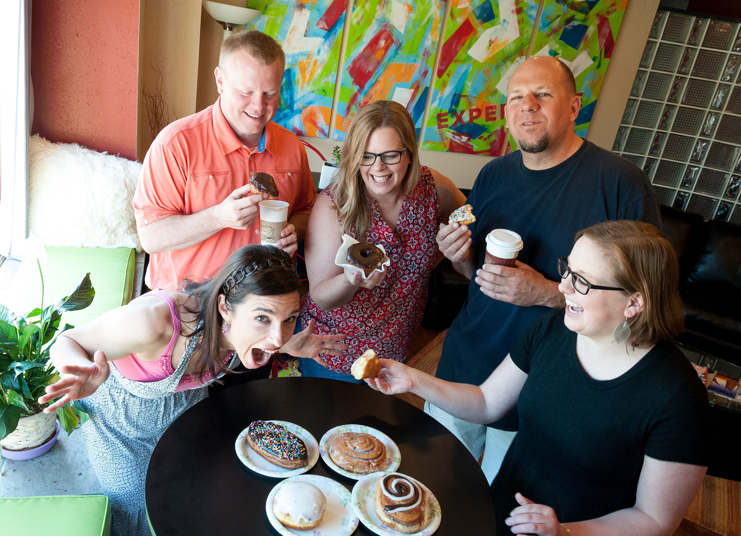 Portrait of group with donuts