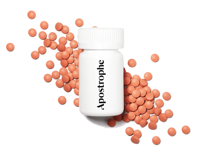 Apostrophe Pharmacy finasteride pill bottle and pills.