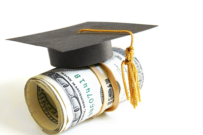 A roll of dollars with a graduation cap on it