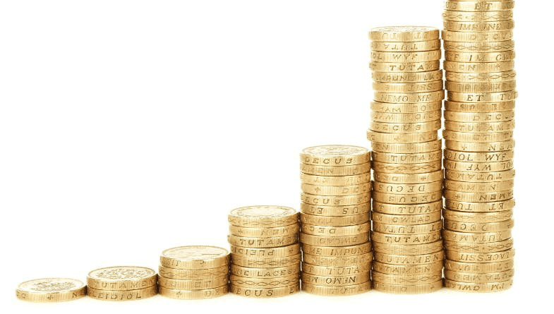 Gold coins in stacks going up in size.