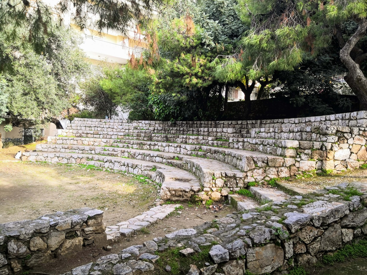 Small stone theater inside a park