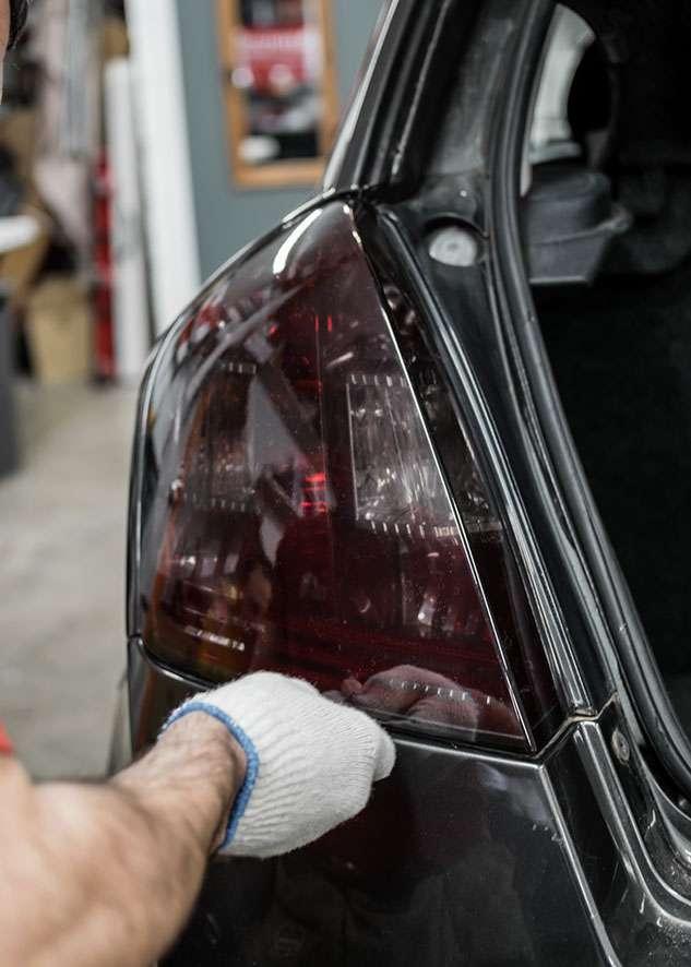 Fiat Stilo car left side rear light being tinted using LUXE Light film