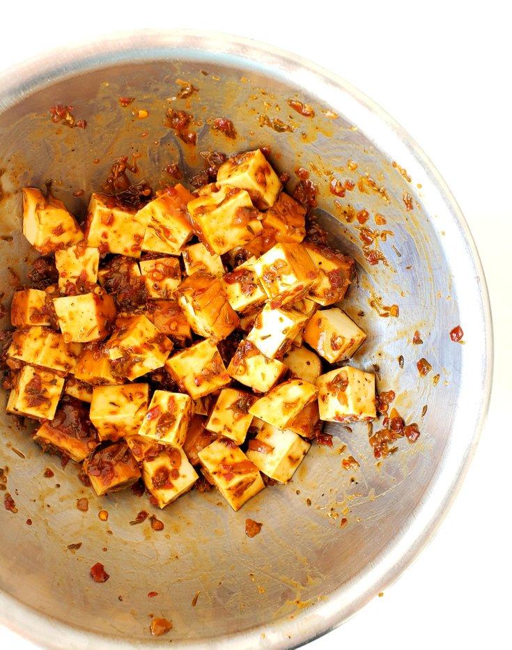 Bowl of Cubed Tofu Tossed in Jerk Sauce
