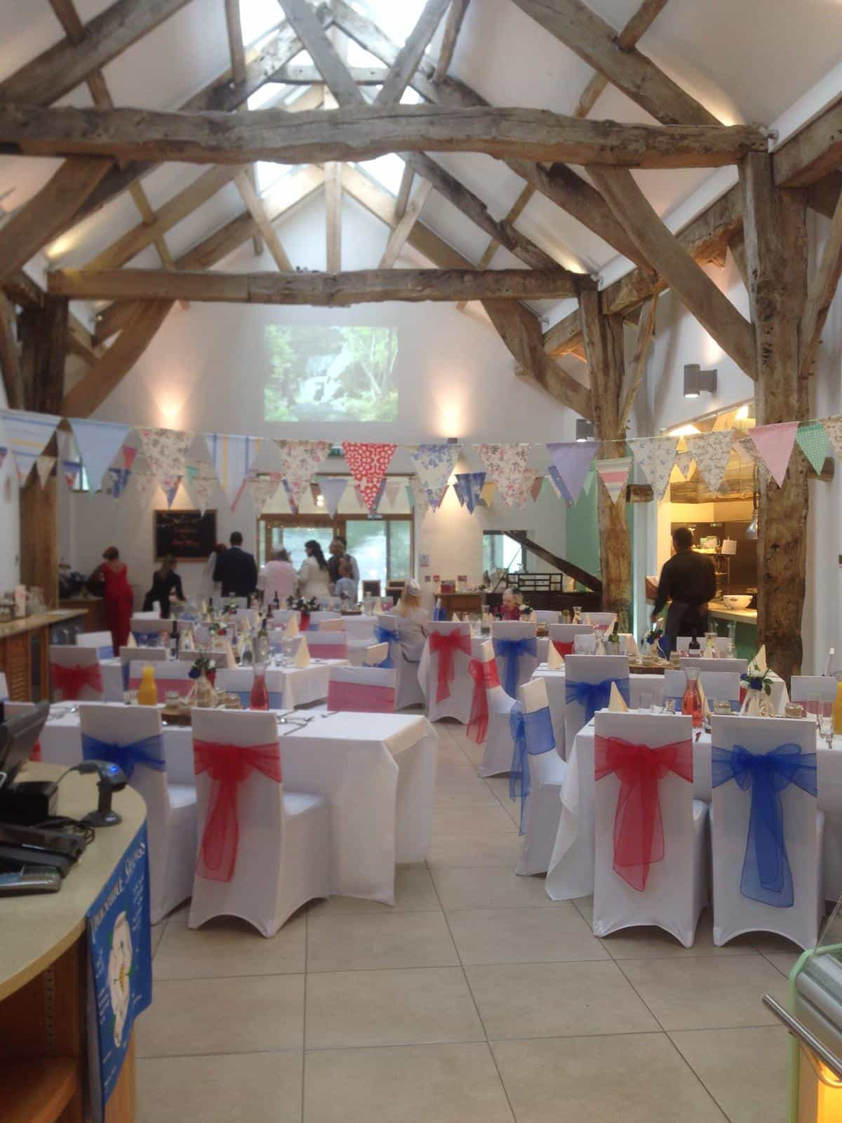 Baby shower venue dressing event with red and blue decoration to tables and chairs