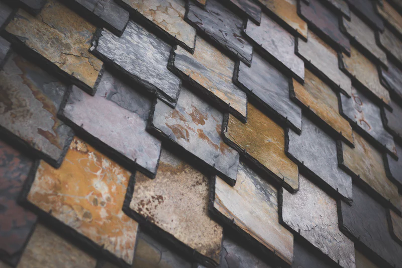 shingles made from reclaimed waste and other recycled materials