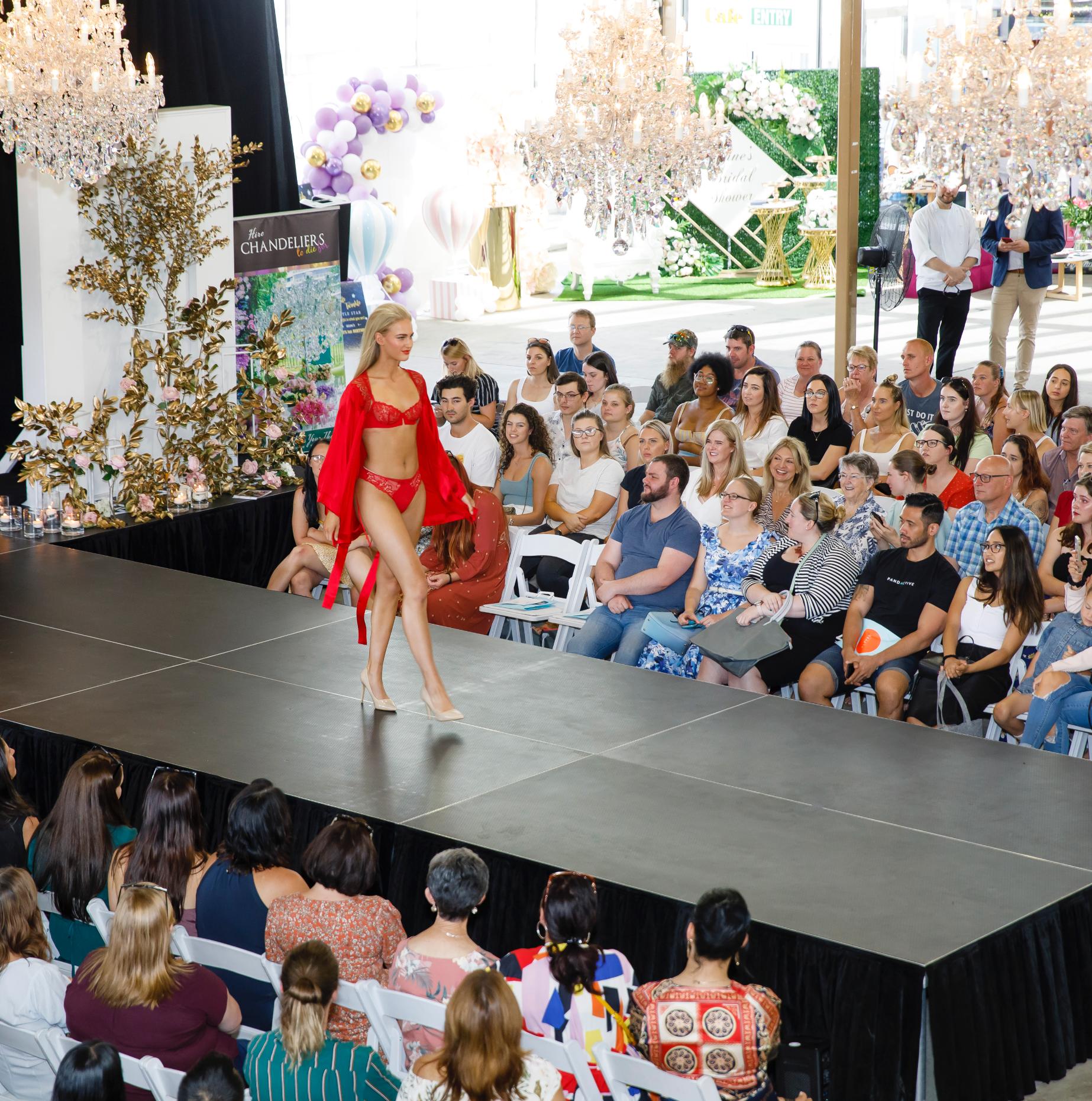 women in lingerie modelling on stage