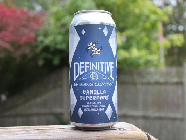 Vanilla Superdome, a Milkshake Double IPA brewed by Definitive Brewing Company