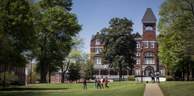 Students walking on the quad on a sunny day at Morehouse College
