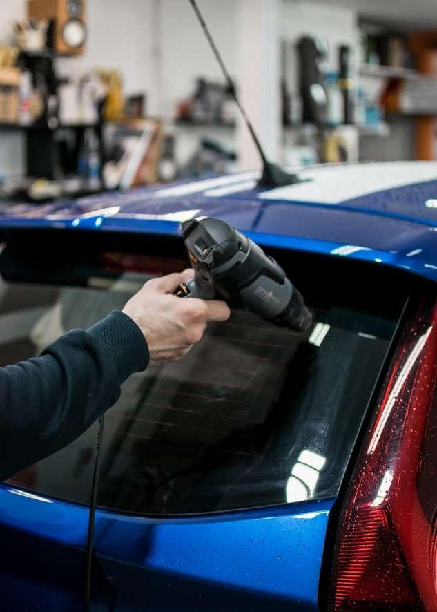 Blue MG3 car rear window tint being heated