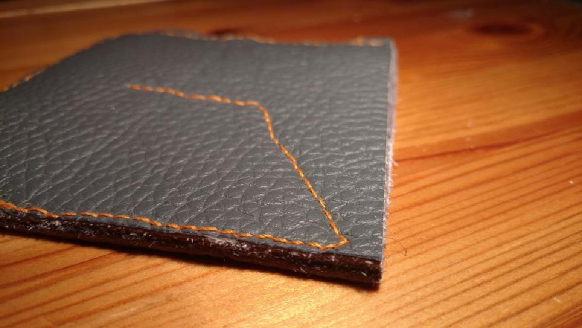 A close up picture of the stitching on the finished coin wallet