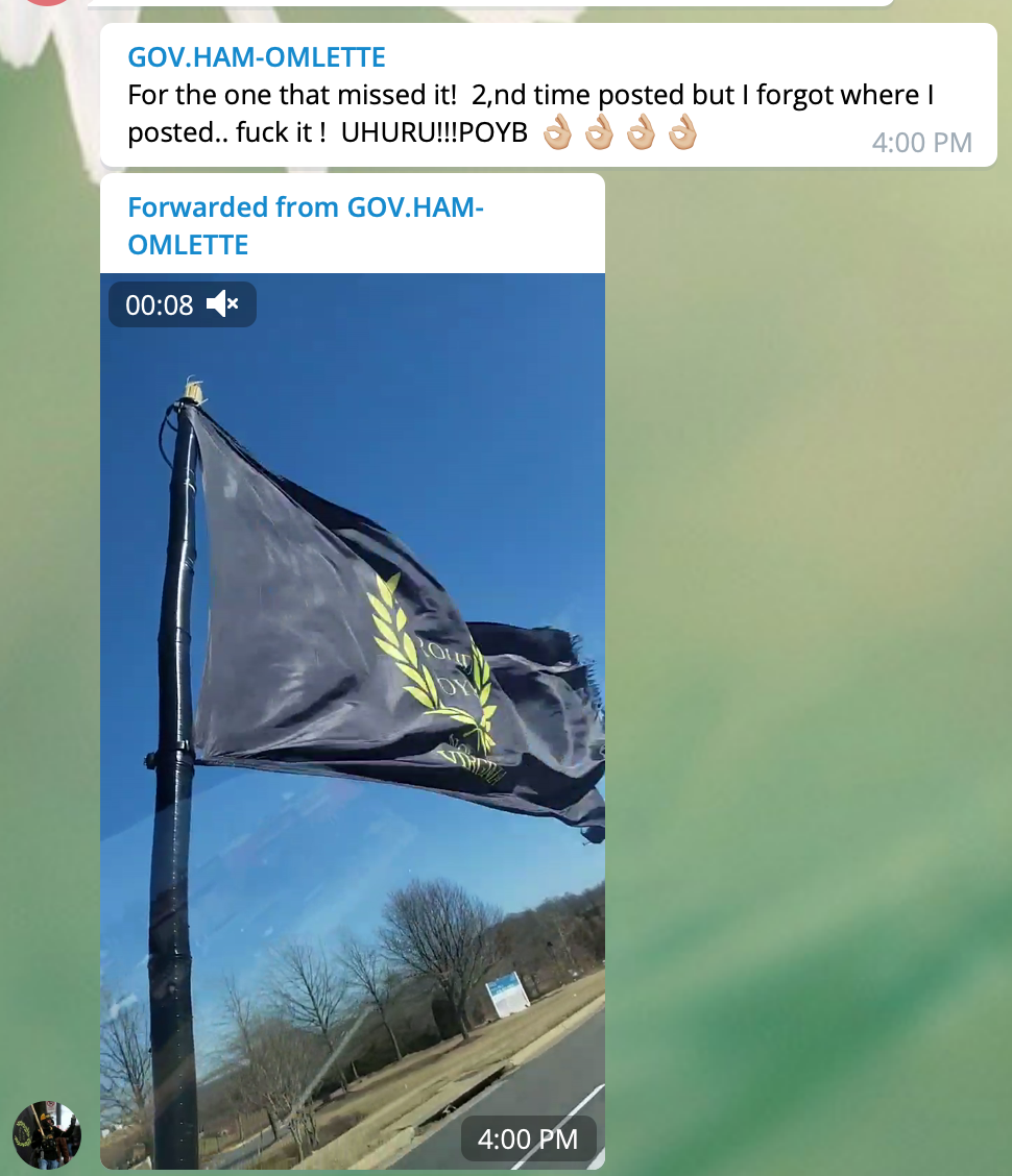 A user named 'GOV. HAM-OMLETTE', identified as Virginia Proud Boy Russell Hampton Ouelette, posts a video of a flying Proud Boys flag in the 'Patriot Party National ' channel. The attached post reads: 'For the one that missed it! 2,nd time posted but i forgot where I posted.. fuck it ! UHURU!!!POYB 👌👌👌'