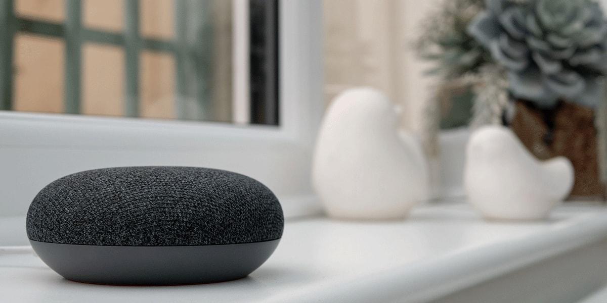A Google Home device on a windowsill