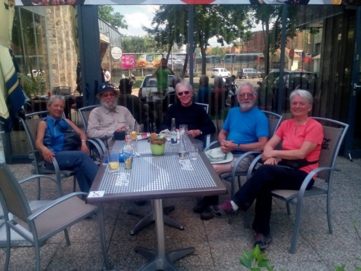 elderly trekkers sat down on a café's terrace in Győr, Hungary