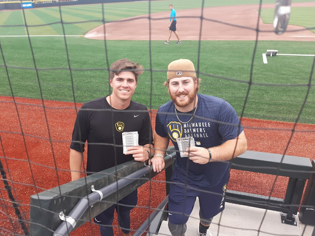 Timer Rattlers player with Chipotle gift cards.