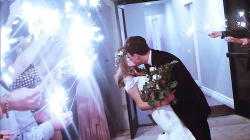 Sparkler send off Ben and Amelia kiss