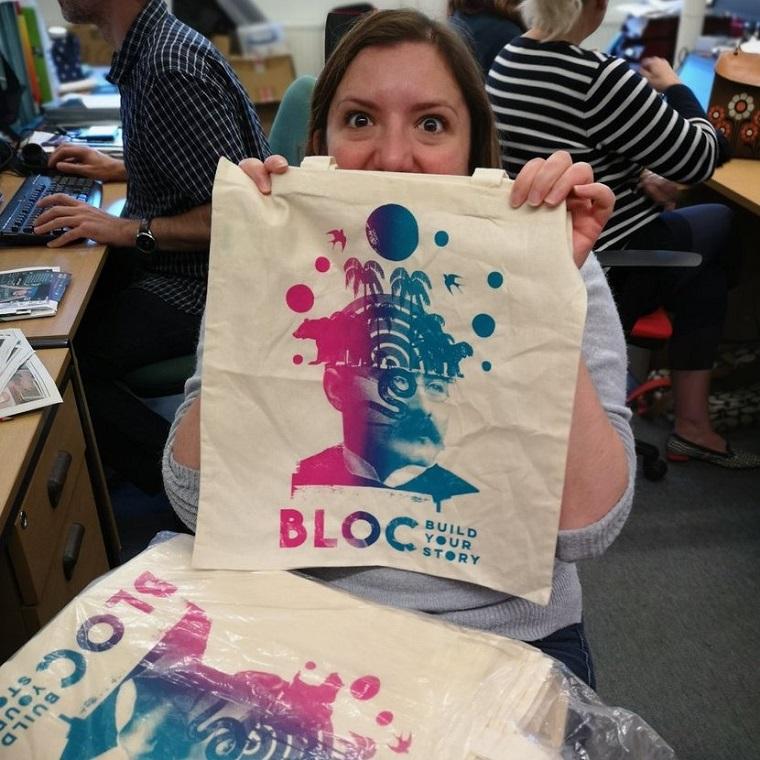 Woman displaying BLOC bag
