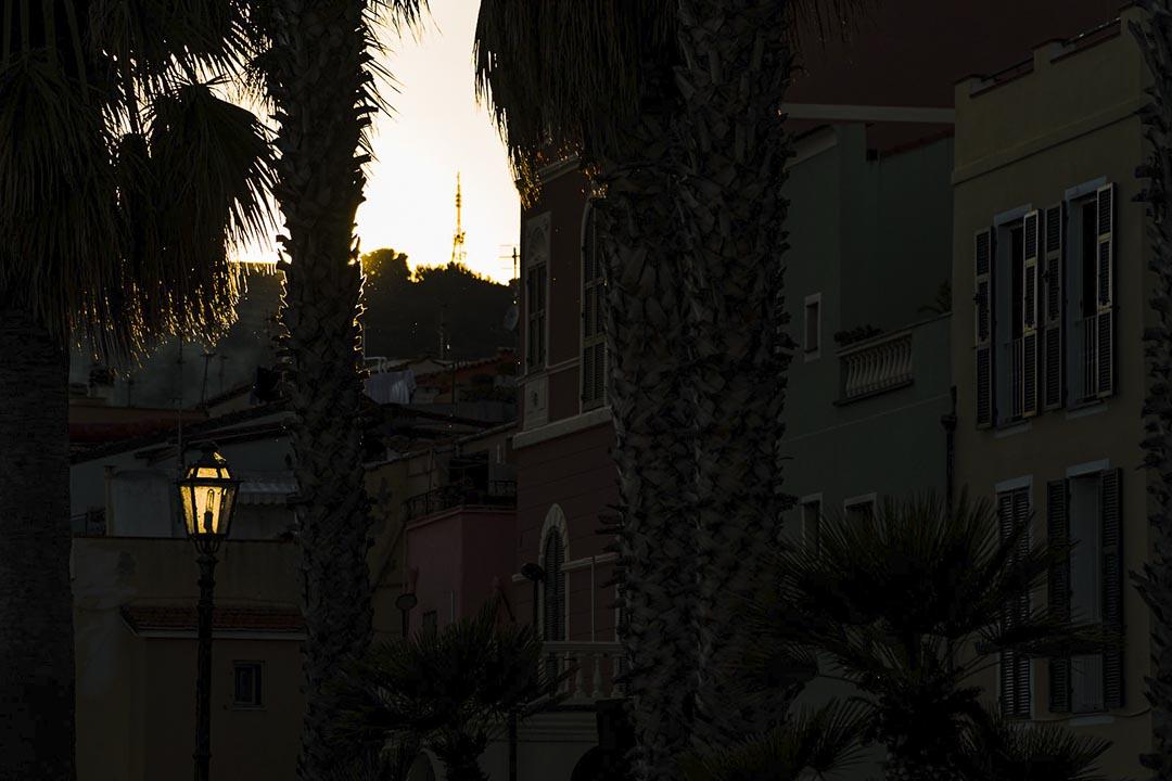 a streetlamp lit by sunlight