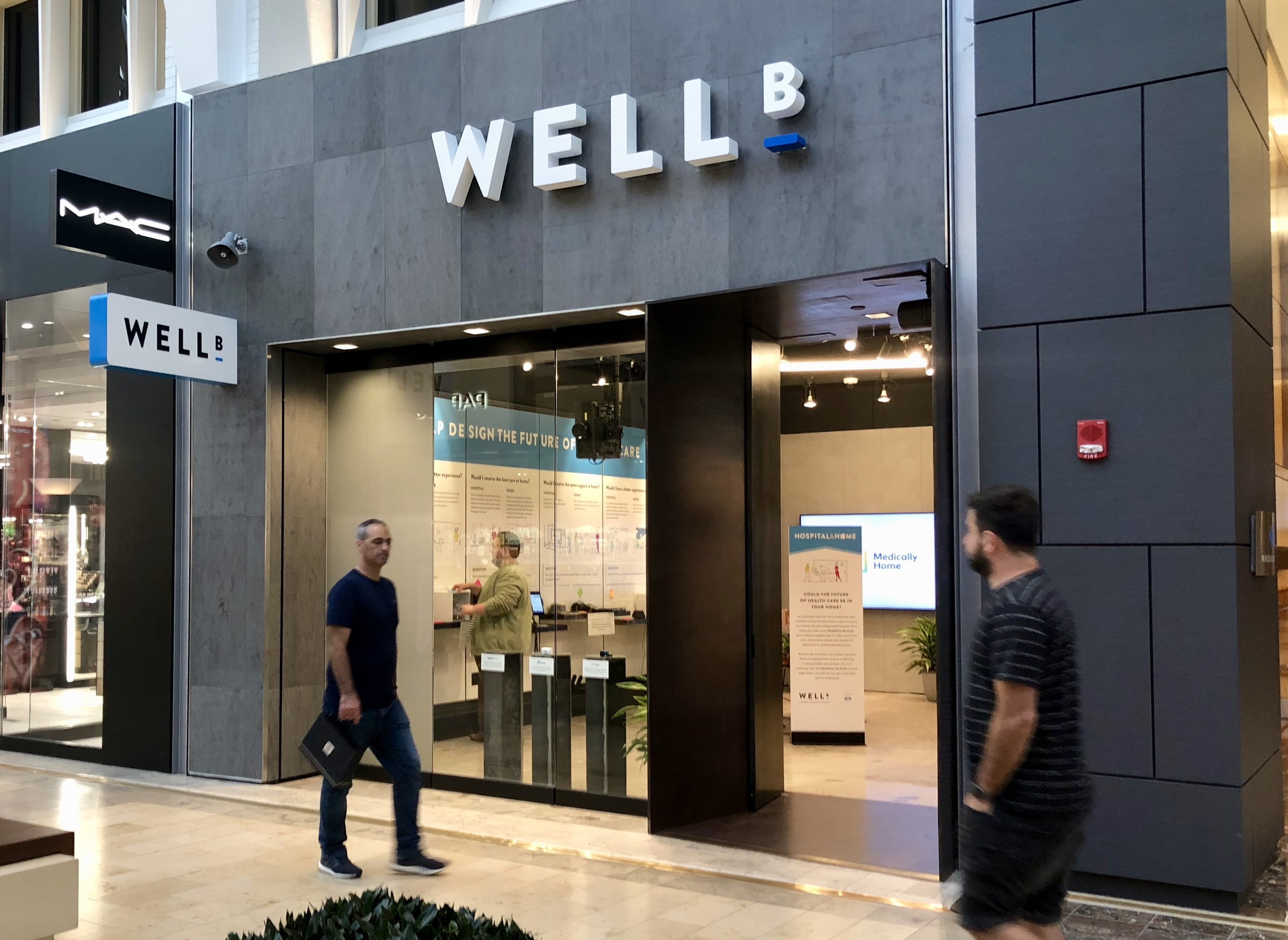 exterior view of Well_B retail/innovation space with people walking by
