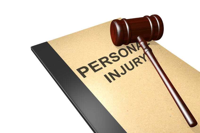 personal injury notebook and gavel