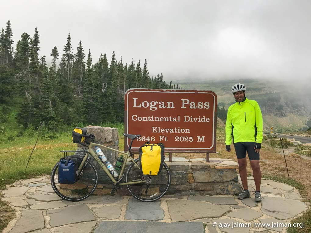 At Logan Pass [elevation 6,646 ft (2,026 m)] along the Continental Divide in Glacier National Park. While attempting a solo ride across America – 2017