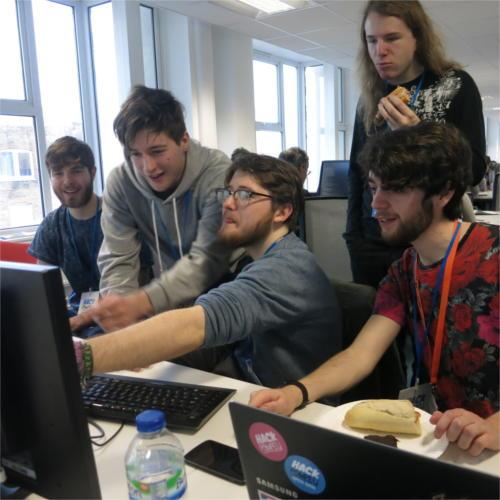 Some lads gathered round a Raspberry Pi