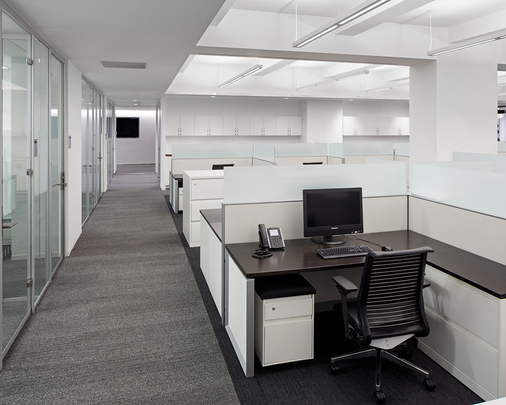 Open Office with Hanging Utility Lights and Glass Walls