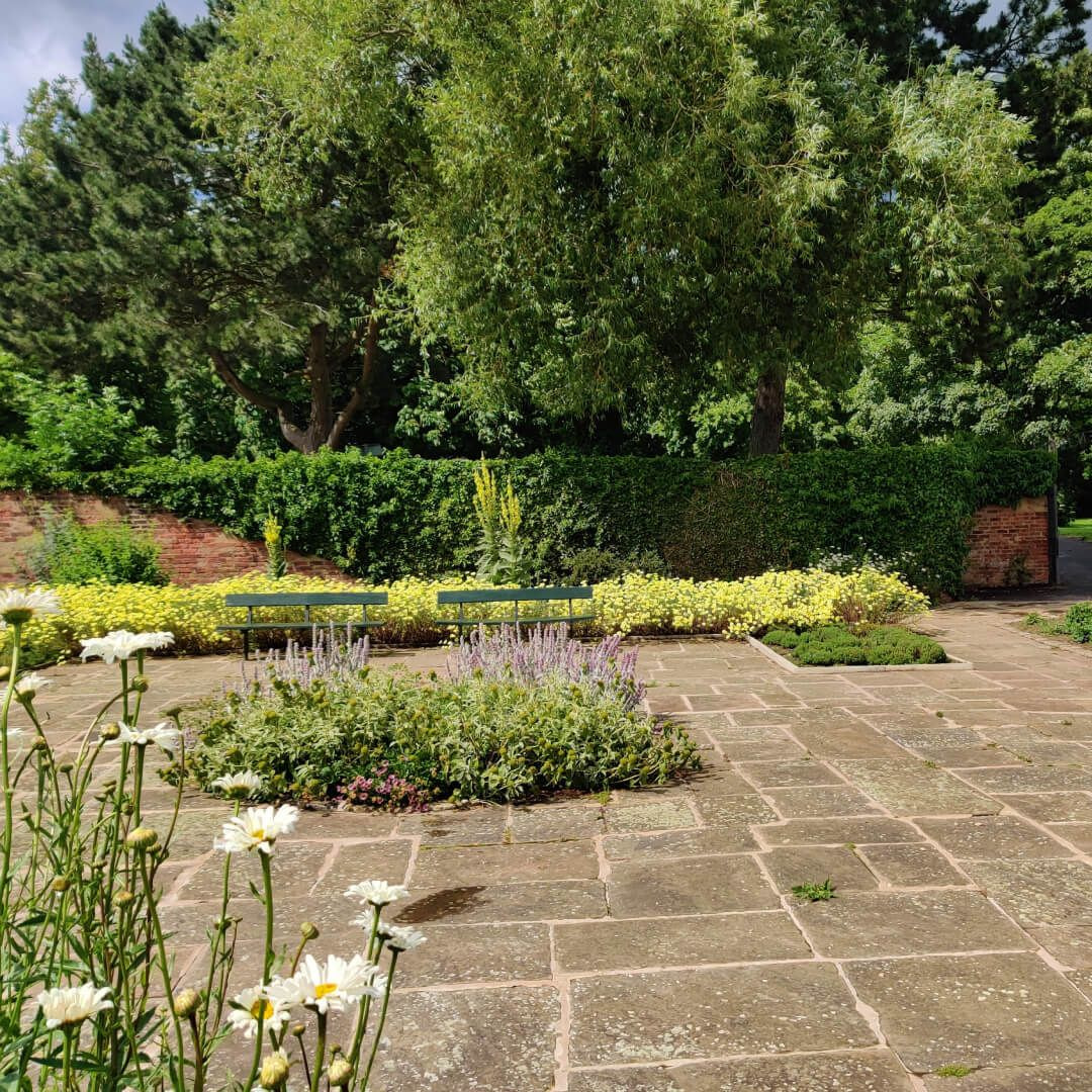Gotts Park Rose Garden Stone slabs and surrounding hedges