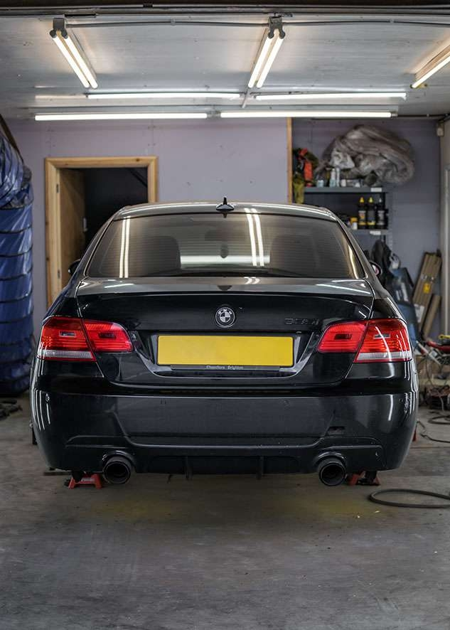 Rear of BMW 335i car with poor/bad/dull paint job before polishing