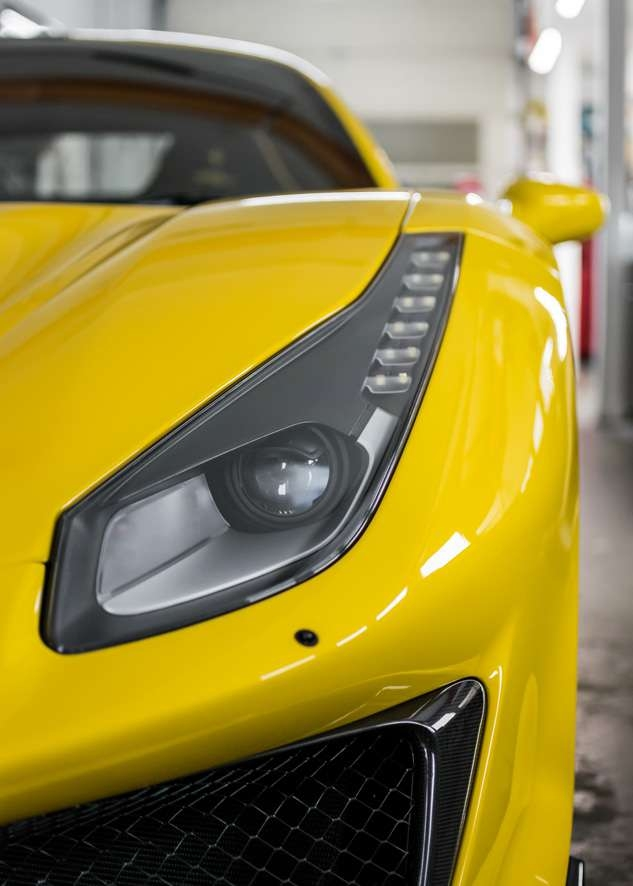 Close up shot of car yellow Ferrari 488 Pista after paintwork protection, paint protection film (PPF) and ceramic coating application.