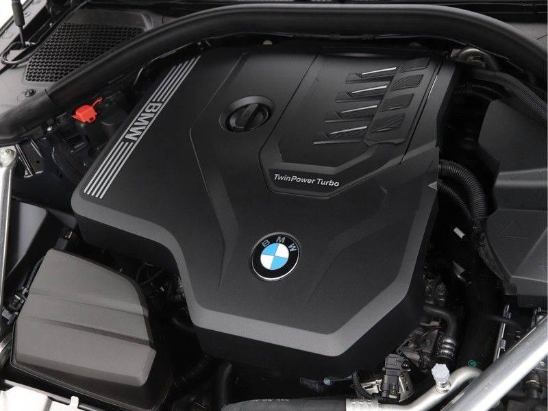 BMW 4 Serie 420i Coupé High Exe M-Sport Aut. afbeelding 4