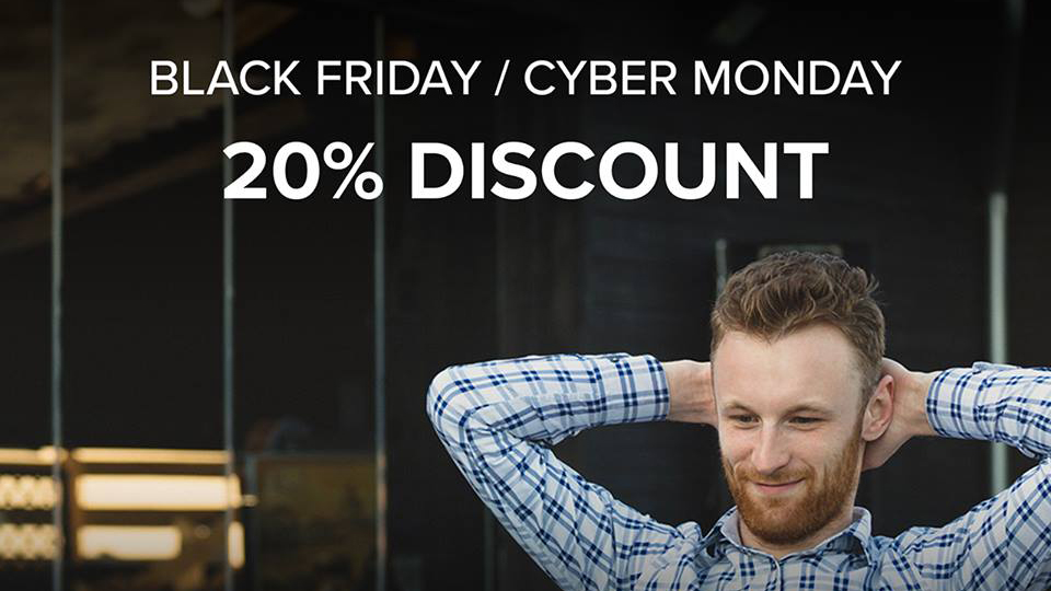 Relaxed person with a laptop and Black Friday / Cyber Monday discount offer