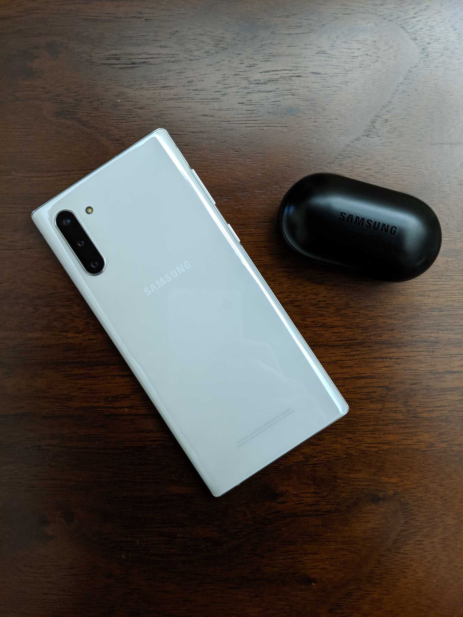 Samsung Galaxy Note 10 with the Galaxy Buds on a table