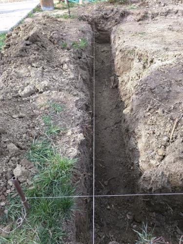 Initial trench being dug, with string lines to guide where the trenches need to go.