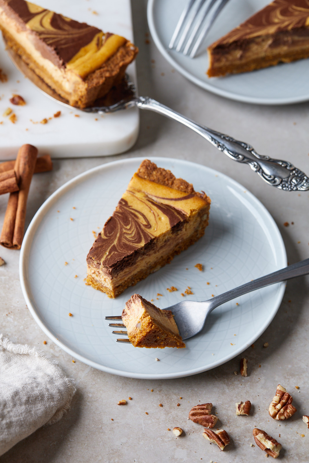 Marbled Chocolate Cheesecake Pumpkin Tart With A Biscoff Pecan Crust