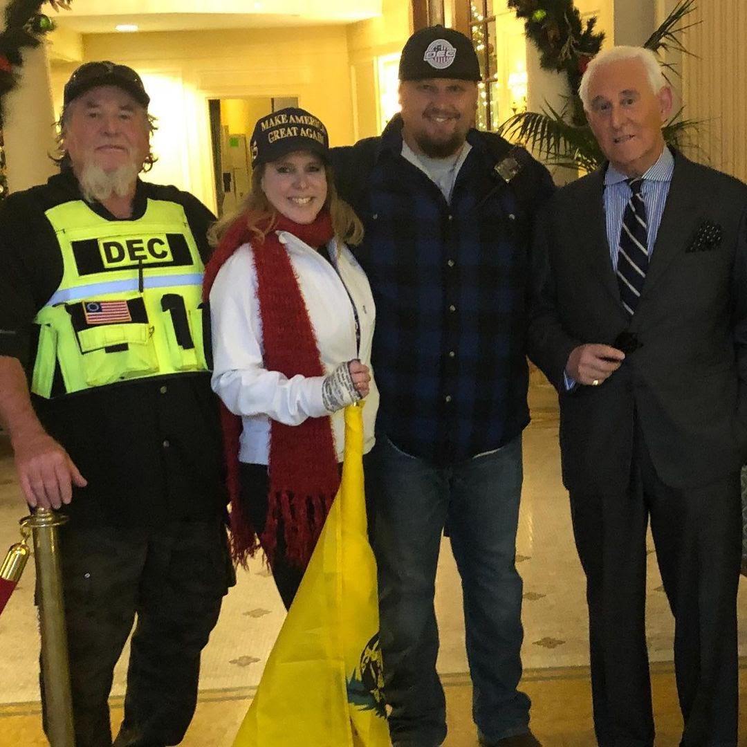 Haskins and other DEC members with Roger Stone