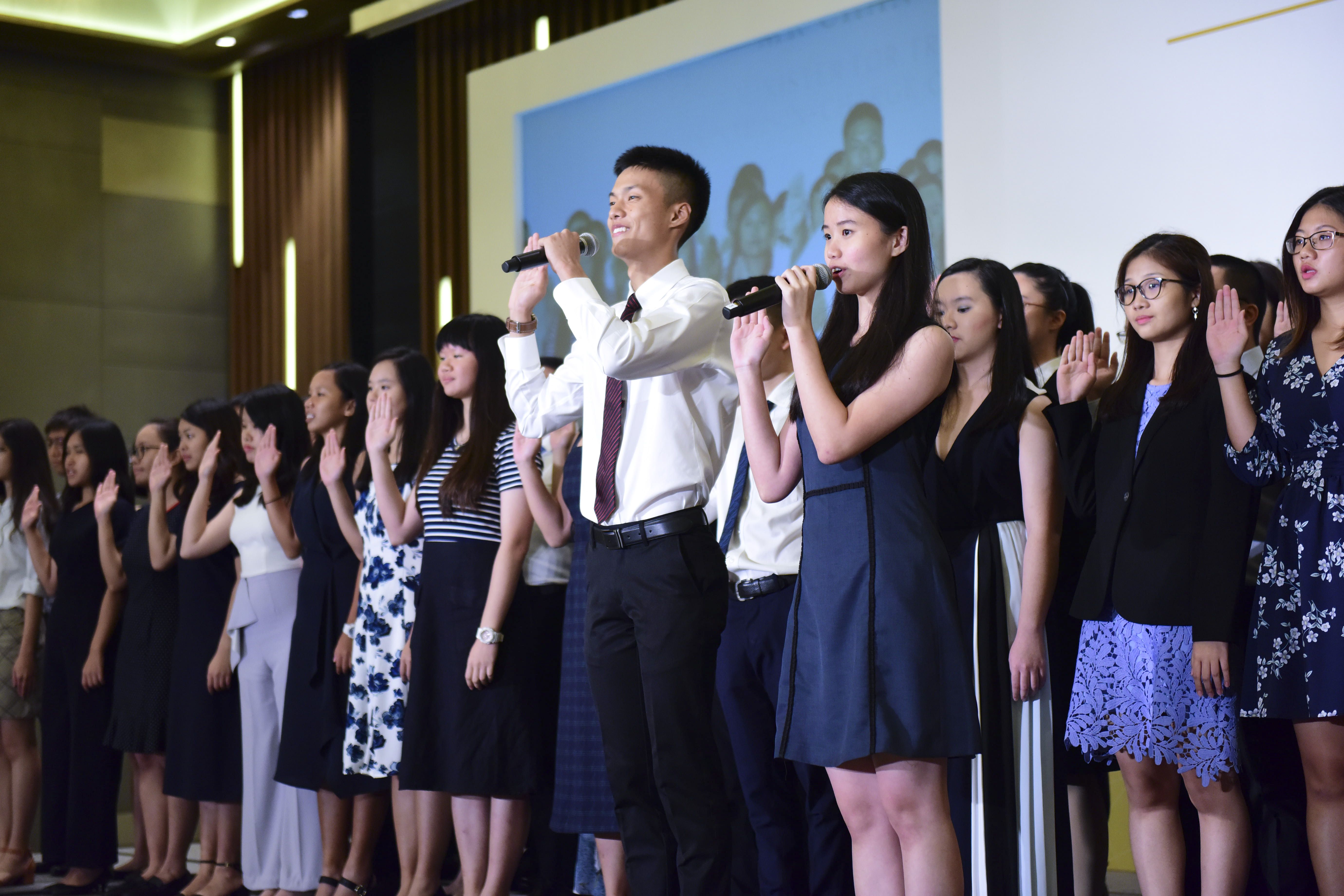 alt text - scholarship recipients taking the scholarship holders' pledge at the 2019 PSC Scholarships Award Ceremony