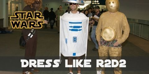 R2-D2 is a cylinder with three wheeled arms and capped off with half a sphere. Its color scheme includes predominantly white and blue with a few details in silver.