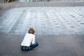 Studying the water fountain at Granary Square.