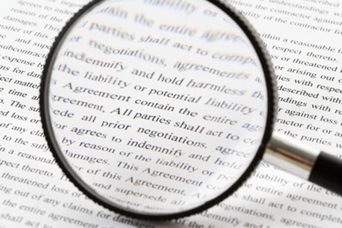 Magnifying glass and small print