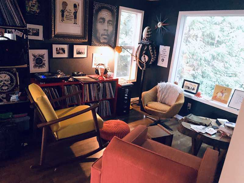 a room with several chairs and vinyl records