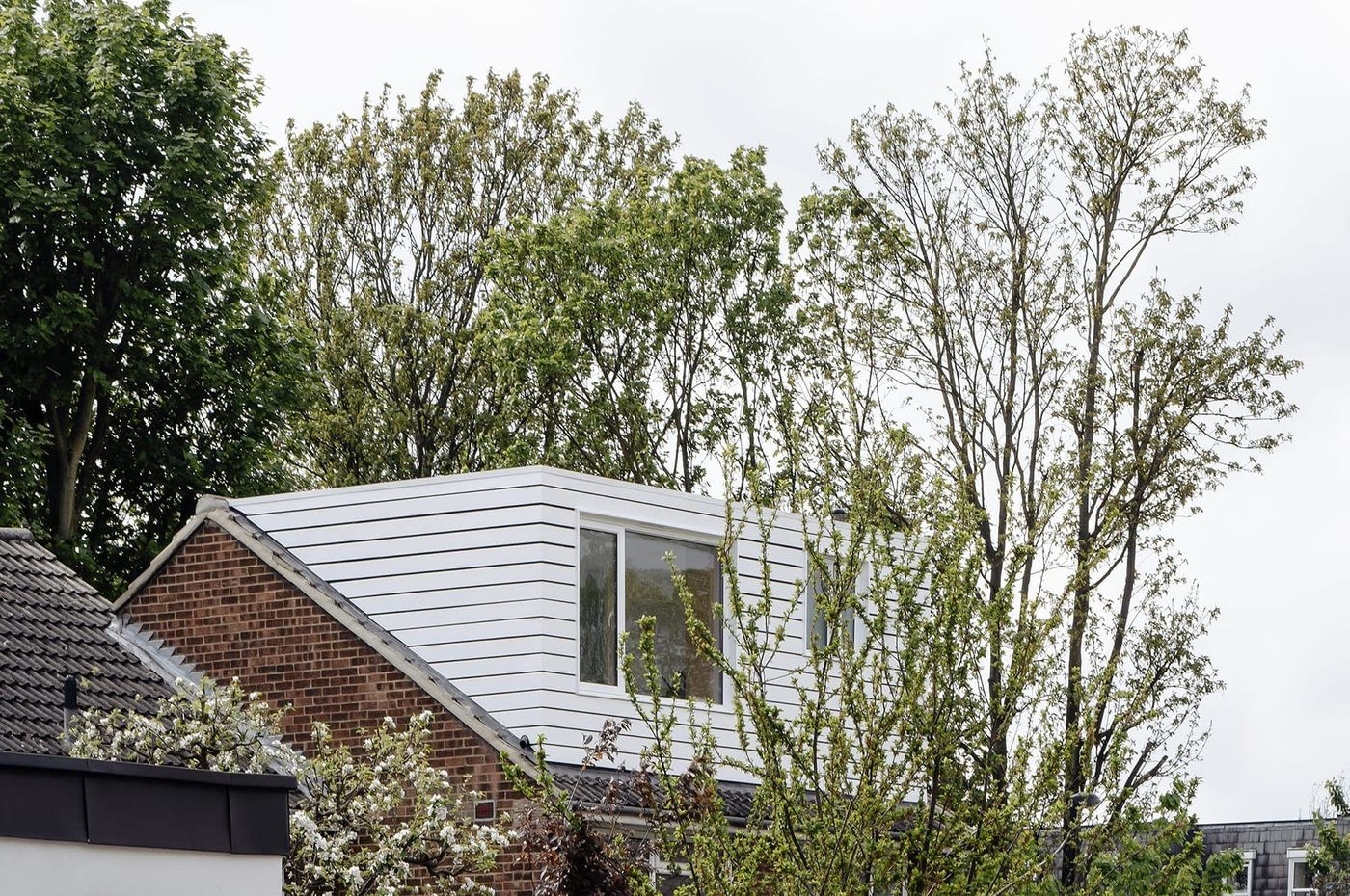 White horizontally clad timber dormer extension designed by From Works in Blackheath, London.