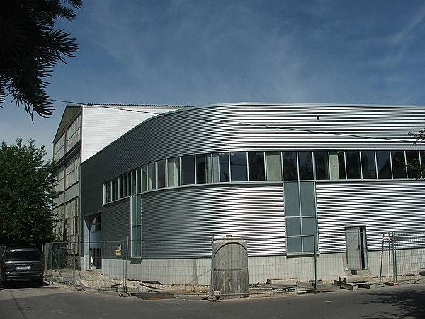 Photo of the new building - a large hall with metal-faced facade