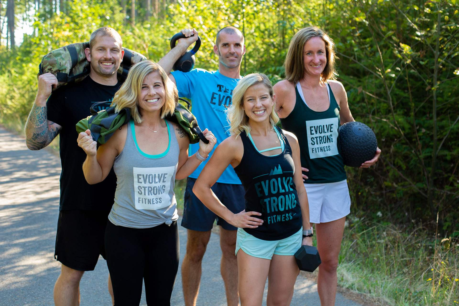 Outdoor fitness class with dumbbells