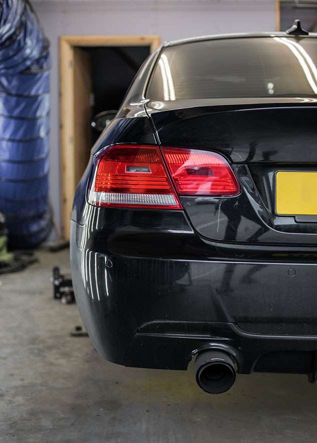 Rear side shot of BMW 3 series car with poor/bad/dull paint job before polishing
