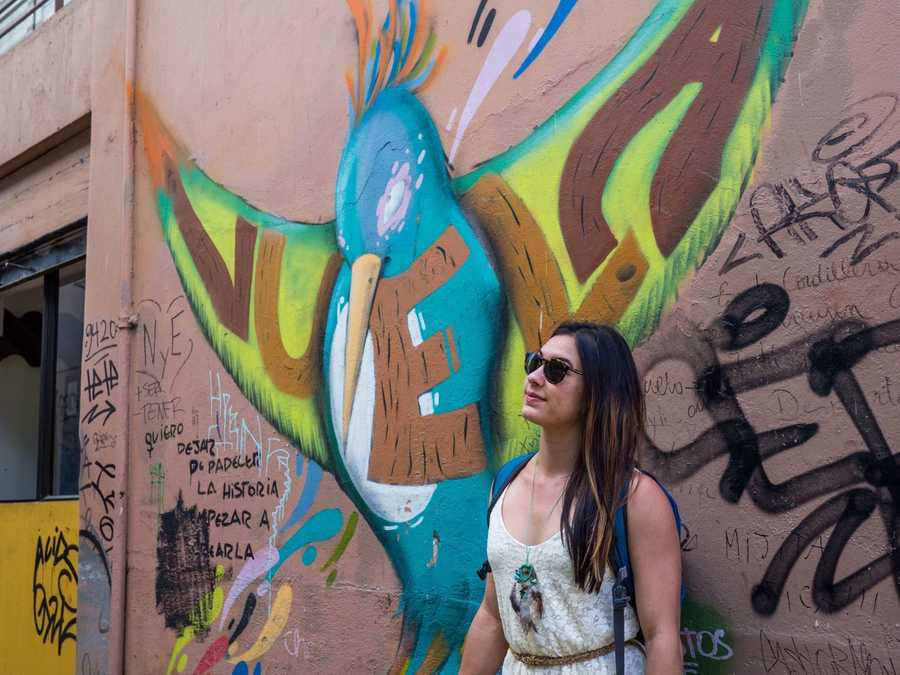 Posing in front of art walls.