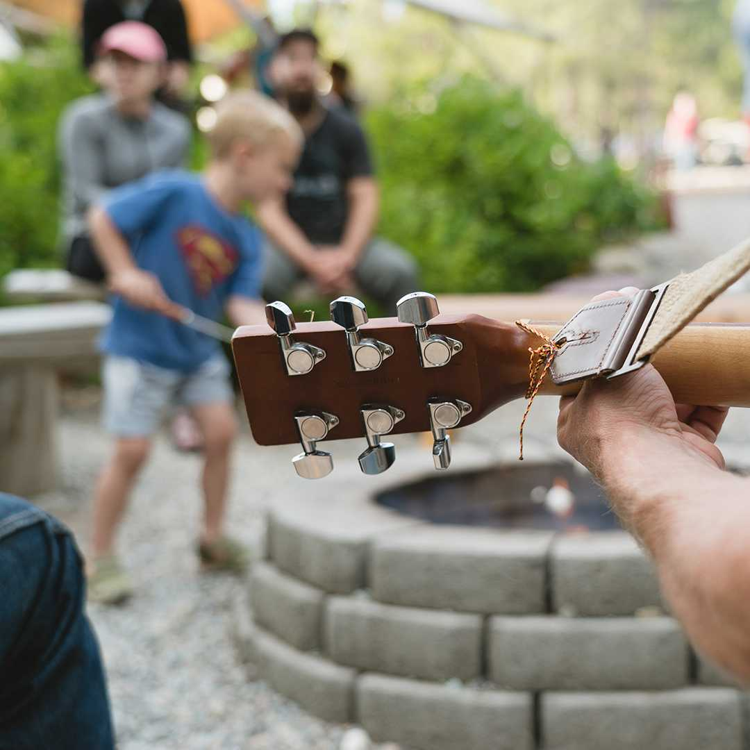 Playing guitar at social gathering