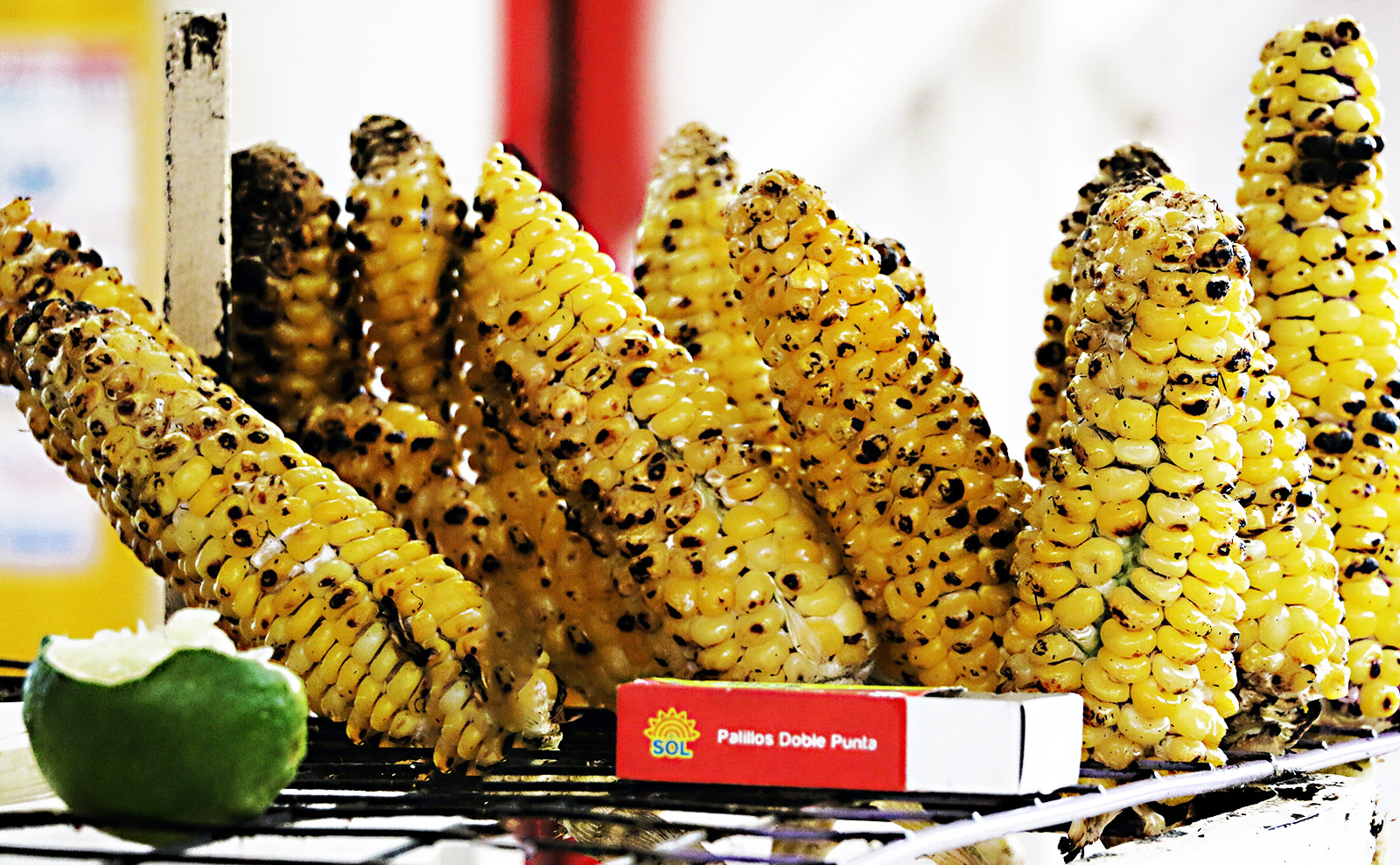 basket of grilled corn on the cob