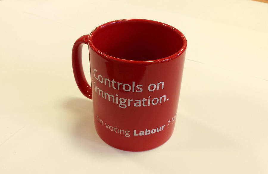 A red mug with the words Controls on Immigration printed on it